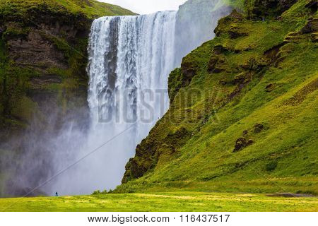 Magnificent famous waterfall Sk�³gafoss, Iceland. A powerful jet Sk�³gar river falls from a large glacier