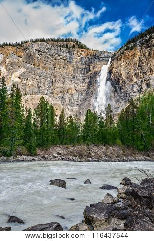 Colossal Takakkaw waterfall formed by melting glacier Daly. Sunny autumn day in Yoho National Park in the Rocky Mountains of Canada