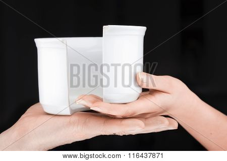 Couple  Holding A Broken Mug