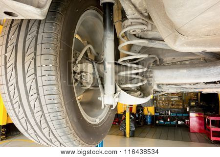Rear Suspension Of Car Lift Up For Maintenance