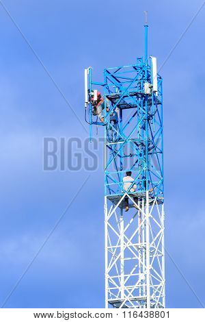 Technician Repairing On Telecommunication Tower