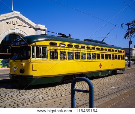 Yellow Tram At Pier 15 In San Francisco, California Usa