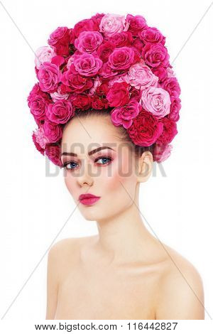 Young beautiful woman with stylish make-up in fancy vintage style wig of pink roses over white background