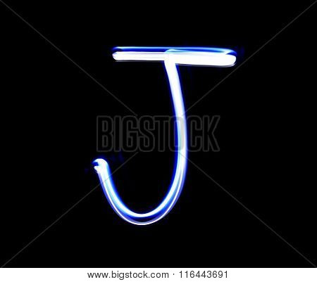 J Jimmy Alphabet Hand Writing Blue Light  Over Black Background.