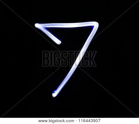 Seven Blue Light Digit Hand Writing Over Black Background.