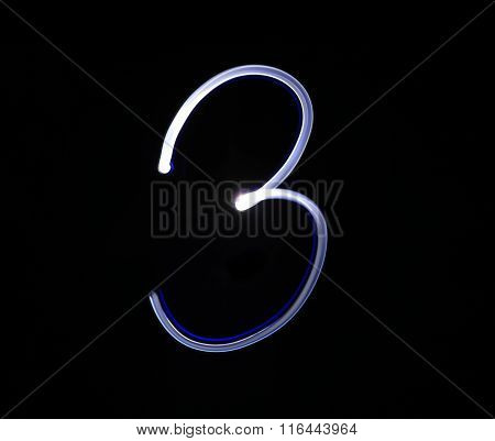 Three 3 Blue Light Digit Hand Writing Over Black Background.