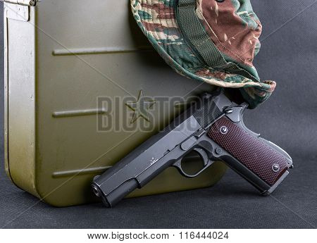 Box For Bullets, A Gun And A Camouflaged Hat