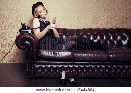 Pretty Woman Sitting On Sofa