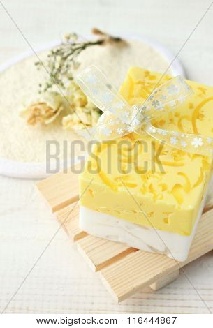 Yellow herbal soap bar.