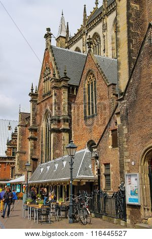People Walking Near The Grote Kerk (sint-bavokerk) In The  Historic Center Of Haarlem, The Netherlan