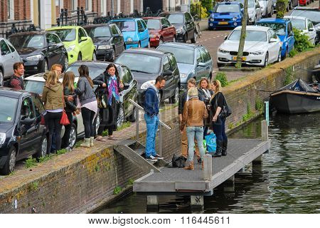 People Waiting A Boat Near The River Canal (nieuwe Gracht) In Haarlem, The Netherlands