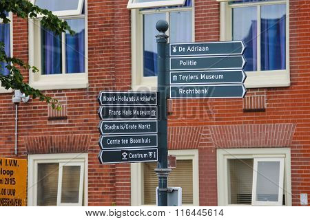 Tourist Signpost At The Crossroads In Harlem, The Netherlands