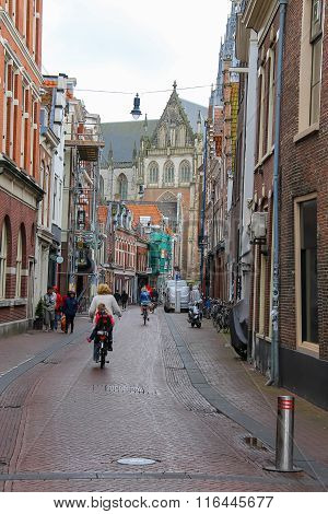 People On The Narrow Smedestraat Street In The  Historic Center Of Haarlem, The Netherlands