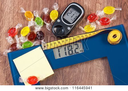 Electronic Bathroom Scale And Glucometer With Result Of Measurement And Colorful Candies, Diabetes,