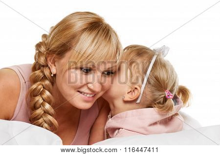 whispering little girl and mother