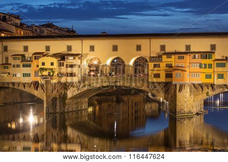 View of Gold (Ponte Vecchio) Bridge at night in Florence, Tuscany, Italy