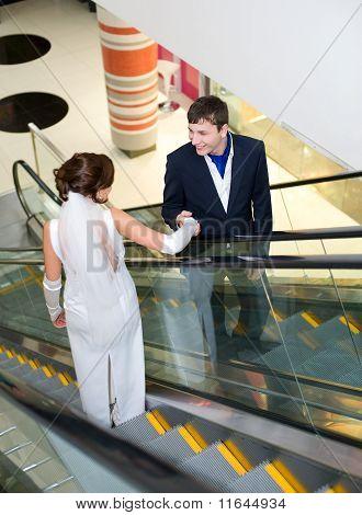 Bridegroom And Bride On Escalator