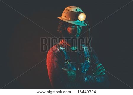 Portrait Of Miner Wearing With Arms Crossed