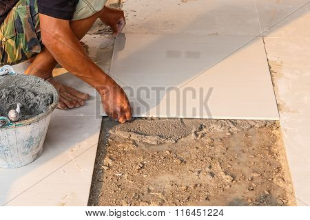 Labor Installing Tile Floor For New House Building