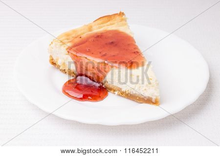 Piece Of Cheesecake On White Saucer