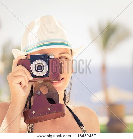 Young Happy Woman Having Fun With Old Camera
