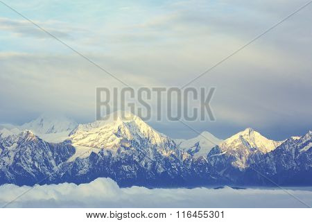 beautiful  clouds and frozen mountain summits landscape