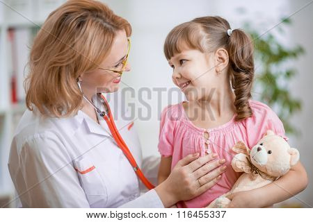Pediatrician talking positively with kid