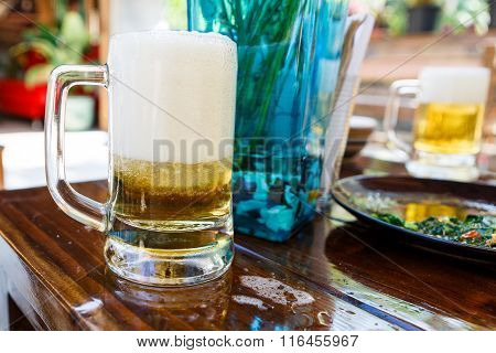 Beer With Foam In Restaurant