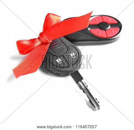 Gift car keys with red bow, isolated on white