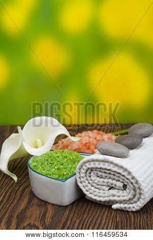 Spa concept ( zen stones, sea salt, towel and flowers).