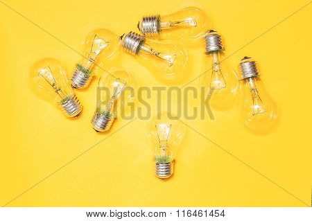 Light bulb on yellow background