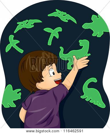 Illustration of a Boy Enjoying the Glow in the Dark Dinosaurs figures