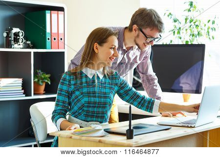 Smilling Young Woman And Man Working From Home