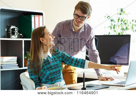 Smillingl Young Woman And Man Working From Home
