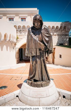 Statue of Francois Grimaldi disguised as a monk with a sword und