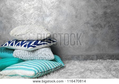 Decorative pillows on grey background