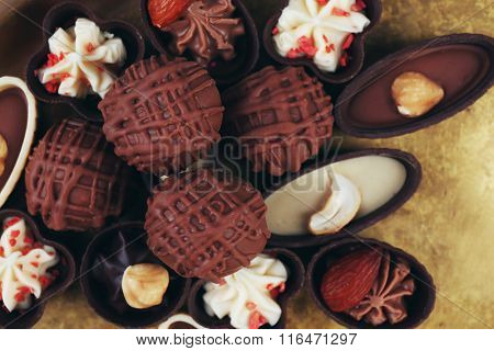 Chocolate sweets on a metal tray, closeup