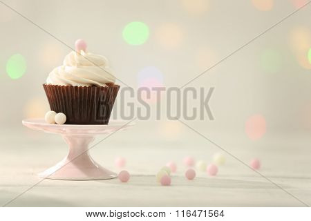 Chocolate cupcake on blurred background