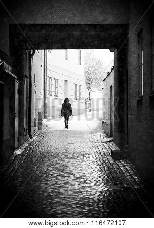 Person Walking In Alley
