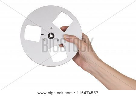 Female Hand Holding Empty Reel Of Tape Recorder