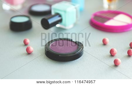 Eye shadows with blush balls on a table