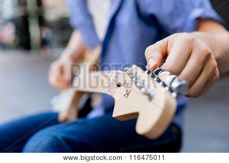 Hands of musician with guitar