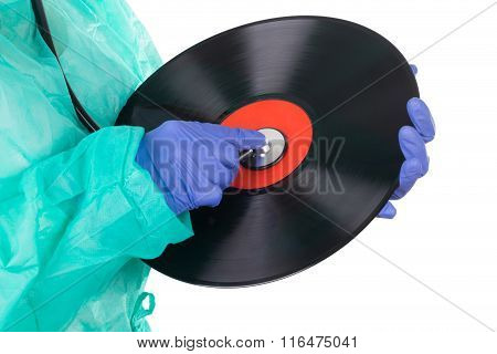 Female Doctor With Stethoscope And Music Plate