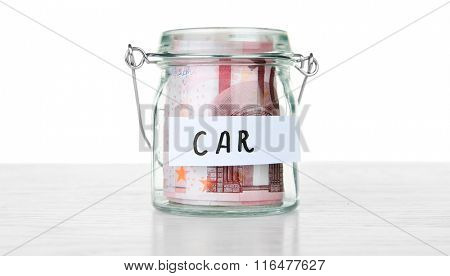 Jar for savings full of coins