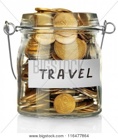 Glass jar with Ukrainian coins for travel, isolated