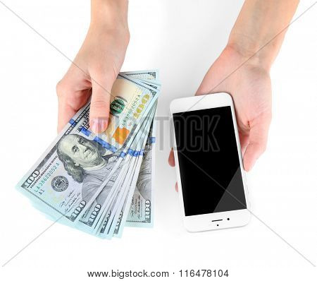 Hands holding smart phone and dollar banknotes, isolated on white. Internet earning concept