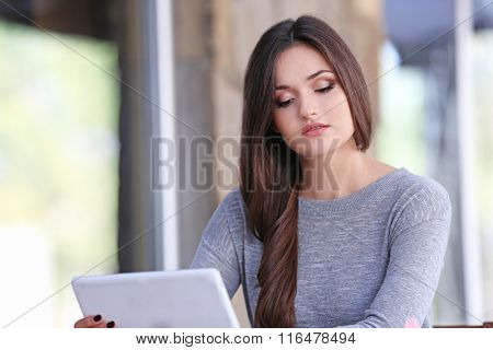 Young woman working with tablet in the office