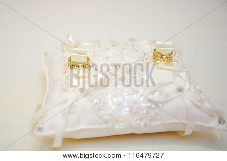Gold Wedding Rings On The Pincushion For Ceremony