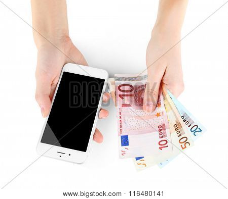 Hands holding smart phone and euro banknotes, isolated on white. Internet earning concept