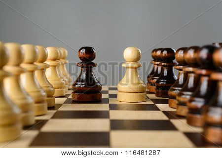 Black And White Pawns Facing Each Other